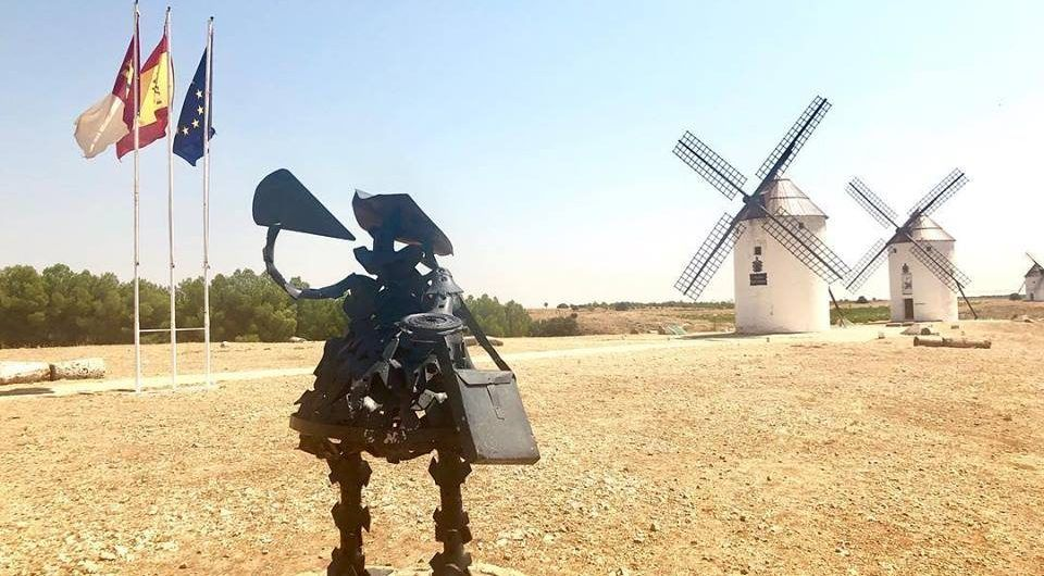 Sancho Panza is drinking wine in the windmills of La Mancha
